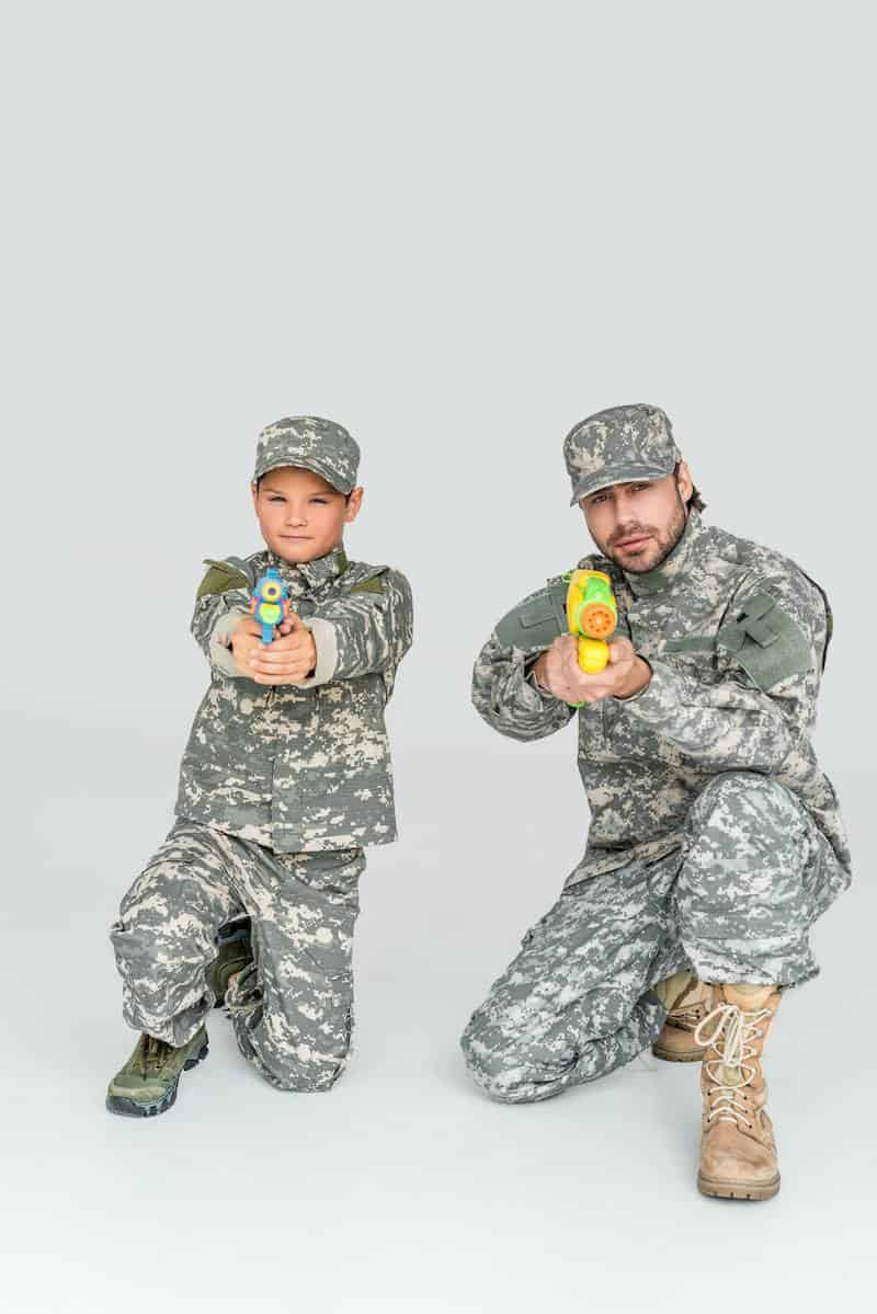 father and kid playing water guns